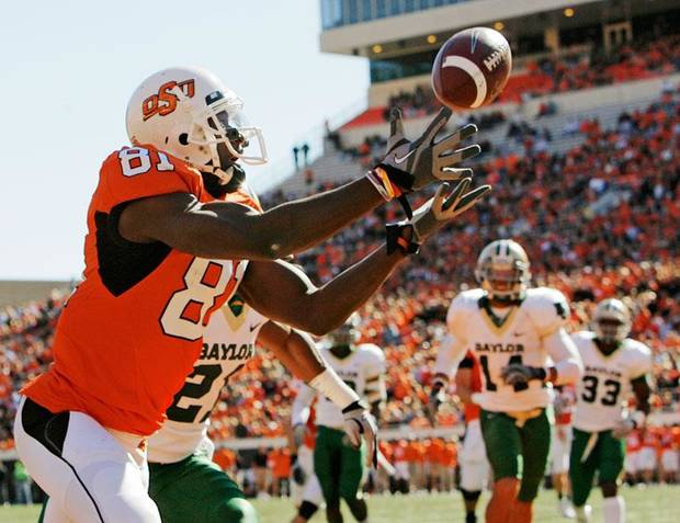 OSU's Justin Blackmon (81) makes a catch for a touchdown in the first quarter during the college football game between the Oklahoma State University Cowboys and the Baylor University Bears at Boone Pickens Stadium in Stillwater, Okla., Saturday, Nov. 6, 2010. Photo by Nate Billings, The Oklahoman