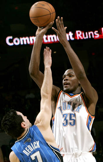 Oklahoma City's Kevin Durant puts up a shot in front of Orlando's J.J. Redick  during the NBA basketball game between the Orlando Magic and the Oklahoma City Thunder at the Ford Center in Oklahoma City, on Sunday, Nov. 8, 2009. By John Clanton, The Oklahoman