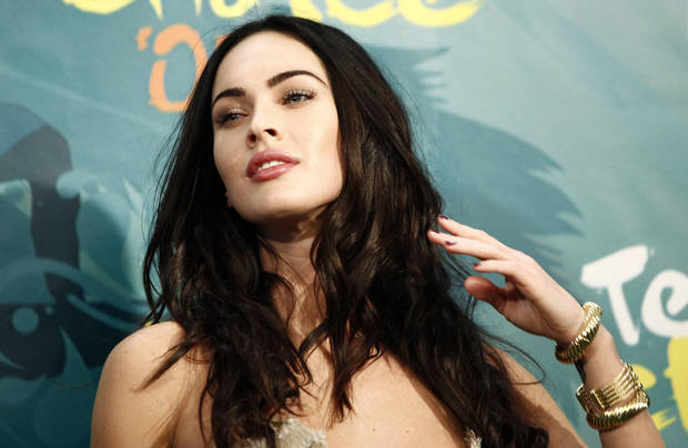 Actress Megan Fox poses backstage at the Teen Choice Awards on Sunday, Aug. 9, 2009 in Universal City, Calif. (AP Photo/Matt Sayles) ORG XMIT: CAMW113
