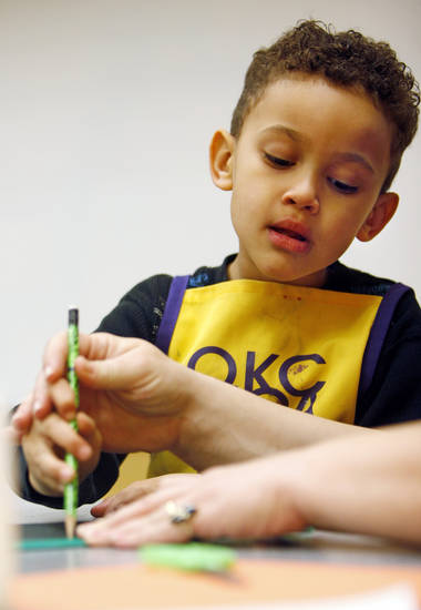 Julius Whatley, 4, works on his lantern with help from his mother, Joy Whatley, during a chinese lantern class for 3- to 5-year-old children at the Oklahoma City Museum of Art in Oklahoma City, Wednesday, Jan. 25, 2012. Photo by Nate Billings, The Oklahoman