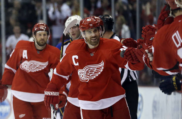 Detroit Red Wings center Henrik Zetterberg, of Sweden, is congratulated by teammates after his second goal during the first period of an NHL hockey game against the St. Louis Blues in Detroit, Friday, Feb. 1, 2013. (AP Photo/Carlos Osorio)