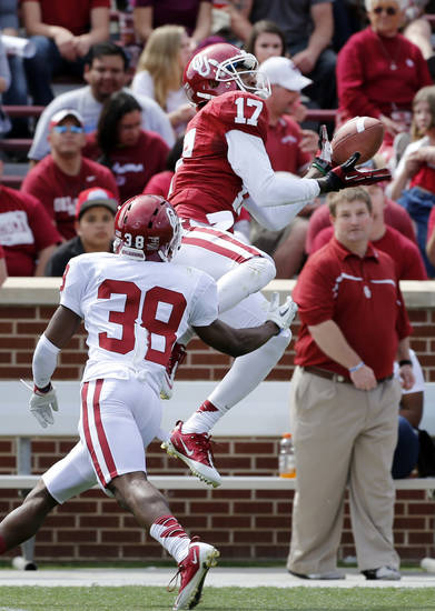 Trey Metoyer (17) catches a pass while defended by Brandon Young (38) during the annual Spring Football Game at Gaylord Family-Oklahoma Memorial Stadium in Norman, Okla., on Saturday, April 13, 2013. Photo by Steve Sisney, The Oklahoman