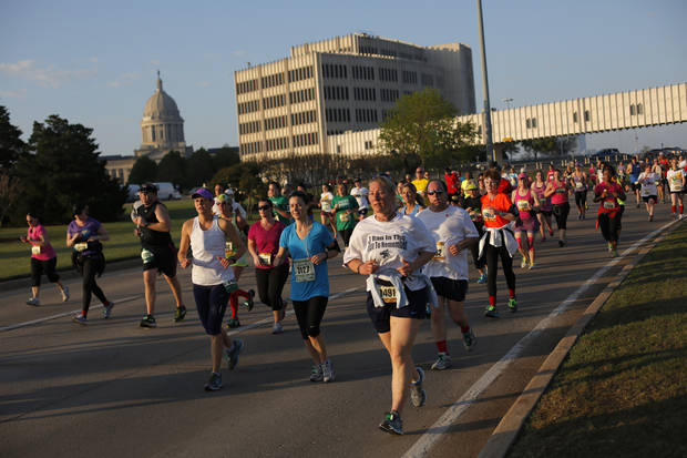 Runners pass the State Capitol Complex during the Oklahoma City Memorial Marathon in Oklahoma City, Sunday, April 28, 2013.  Photo by Garett Fisbeck, For The Oklahoman
