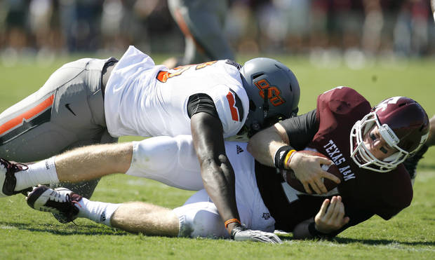 Oklahoma State's Ryan Robinson sacks Texas A&M's Ryan Tannehill during the first half Saturday in College Station, Texas. Photo by Sarah Phipps, The Oklahoman