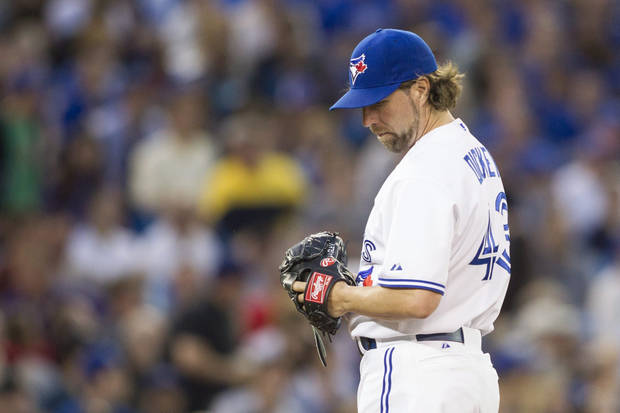 Toronto Blue Jays pitcher R.A. Dickey reacts shortly before being pulled from a baseball game during the seventh inning against the Baltimore Orioles in Toronto, Friday June 21, 2013. (AP Photo/The Canadian Press, Chris Young)