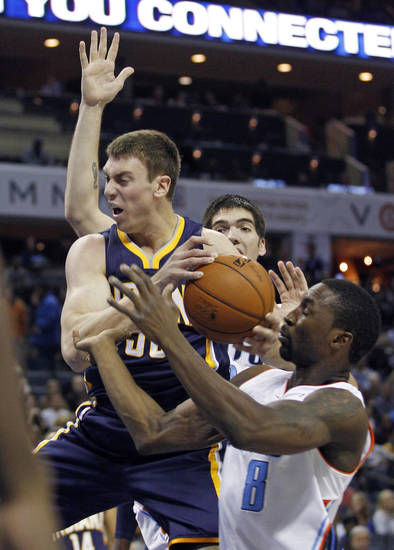 Indiana Pacers' Tyler Hansbrough, left, and Charlotte Bobcats' Ben Gordon, right, wrestle for control of a rebound during the first half of an NBA basketball game in Charlotte, N.C., Friday, Nov. 2, 2012. (AP Photo/Chuck Burton)