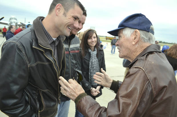 Albert Wheeler, 88, thanks Shawnee resident Drew Walker for buying him a ticket to fly in a B-29 bomber at Wiley Post Airport in Oklahoma City on Saturday. The two had never met when Walker, inspired by the World War II veteran's war stories, decided to send him on the $595 trip. Zeke Campfield - Zeke Campfield