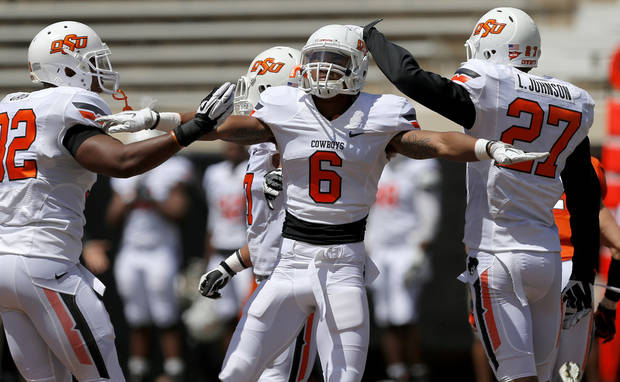 Oklahoma State's Ashton Lampkin reacts after breaking up a pass during OSU's spring football game at Boone Pickens Stadium in Stillwater, Okla., Sat., April 20, 2013. Photo by Bryan Terry, The Oklahoman
