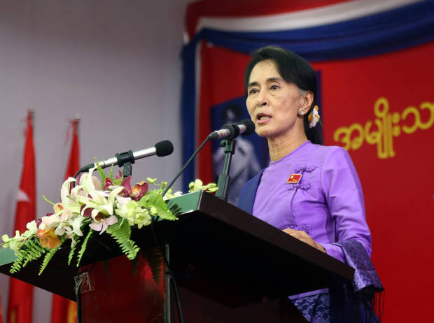 Myanmar's opposition leader Aung San Suu Kyi speaks during the second day session of first ever congress of her National League for Democracy party at Royal Rose restaurant in Yangon, Myanmar, Sunday, March 10, 2013. Suu Kyi has been elected head of the new executive board of Myanmar's opposition National League for Democracy, as the party has a makeover to adjust itself to the country's new democratic framework. (AP Photo/Khin Maung Win)
