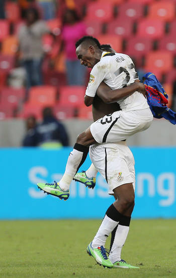 Ghana's Harrison Afful, front, celebrates with captain Ghana's Asamoah Gyan after winning their quarter final African Cup of Nations soccer match against Cape Verde at the Nelson Mandela Bay Stadium in Port Elizabeth, South Africa, Saturday Feb. 2, 2013. (AP Photo/Themba Hadebe)