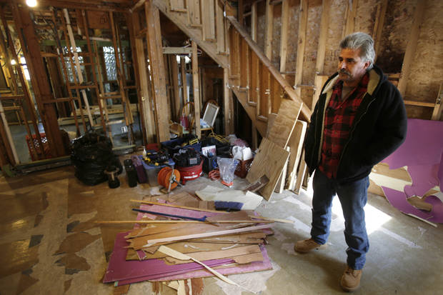 Carmine Colombo looks over his home, which was severely damaged during Superstorm Sandy, in the Broad Channel section of Queens, New York, Thursday, Jan. 3, 2013. Colombo, who has been living in a mobile home while working on the house, is waiting for funds to complete the renovations. Many home and business owners flooded out by Hurricane Sandy could get insurance payouts soon through congressional action expected Friday, Jan. 4 on a $9.7 billion bill to replenish the National Flood Insurance Program. The Federal Emergency Management Agency, which runs the program, warned that it will run out of money next week if Congress doesn&acirc;t give it additional borrowing authority to pay out claims. (AP Photo/Seth Wenig)