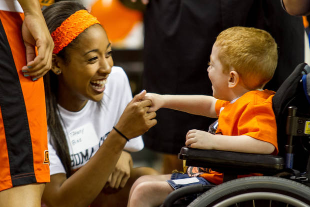Tiffany Bias shakes the hand of Austin Heath.  Oklahoma State University hosted a Coaches vs. Cancer Birthday party in Gallagher-Iba arena in Stillwater, Ok on Sept. 16, 2012. Photos by Mitchell Alcala for the Oklhaoman