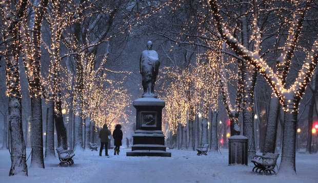 "A couple walks down the illuminated, snow-covered Commonwealth Avenue Mall in Boston, Friday, Feb. 8, 2013. Mass. Gov. Deval Patrick declared a state of emergency Friday and banned travel on roads as of 4 p.m. as a blizzard that could bring nearly 3 feet of snow to the region began to intensify. As the storm gains strength, it will bring ""extremely dangerous conditions"" with bands of snow dropping up to 2 to 3 inches per hour at the height of the blizzard, Patrick said. (AP Photo/Charles Krupa) ORG XMIT: MACK108"