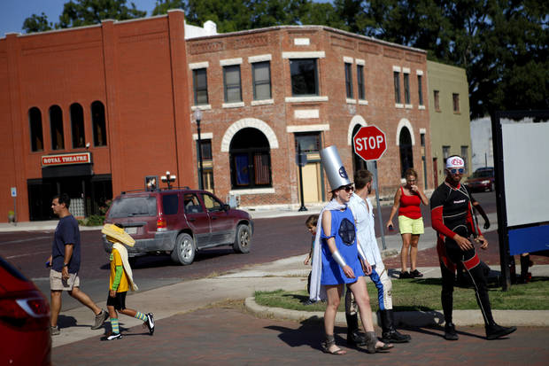 A group of superheroes walk the streets of Pauls Valley during International Superhero Day, Saturday, August 4, 2012. With 124 superheroes taking part, the event attempted to set a world record for the most people in original superhero costumes in one place. The Toy & Action Figure Museum organized the day which also featured a superhero scavenger hunt, super fashion show, and a superhero party. Photo by Bryan Terry, The Oklahoman