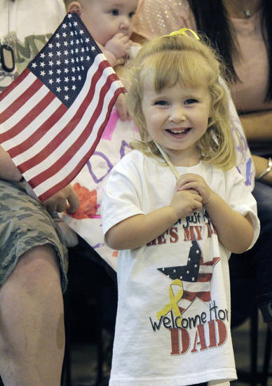 Two-year-old Emma Gore waits patiently for  her father, SFC Jimmy Gore, as around 200 Oklahoma National Guard soldiers with the 180th Cavalry Squadron return to Oklahoma City, OK, from their deployment in Kuwait, Thursday, March 29, 2012,  By Paul Hellstern, The Oklahoman