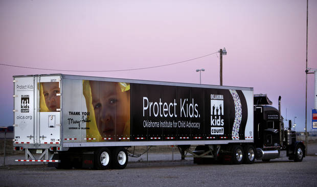 A a tractor-trailer from Western Flyer Express brings awareness to child abuse. The truck sits in a parking lot near Rockwell Avenue and 1-40, Friday, Jan. 13, 2012. Photo by Sarah Phipps, The Oklahoman