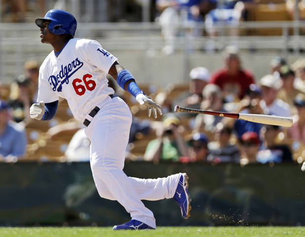 Los Angeles Dodgers' Yasiel Puig singles against the Oakland Athletics during the third inning of an exhibition spring training baseball game on Tuesday, March 19, 2013 in Glendale, Ariz. (AP Photo/Marcio Jose Sanchez)