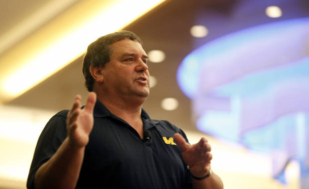 Michigan football coach Brady Hoke speaks at the Michigan High School Football Coaches Associations' Winner's Circle clinic, Friday, Jan. 18, 2013, at the Radisson Plaza Hotel in downtown Kalamazoo, Mich. (AP Photo/Kalamazoo Gazette-MLive Media Group, Mark Bugnaski) ALL LOCAL TV OUT; INTERNET OUT