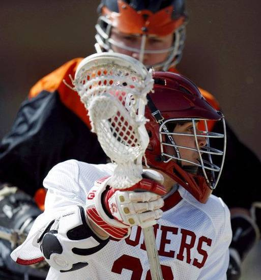 OU's Cameron Alvarez gets past OSU's Andy Martin during a Bedlam lacrosse game Sunday in Edmond. OU won 15-1. PHOTO BY JOHN CLANTON, THE OKLAHOMAN <strong>John Clanton</strong>