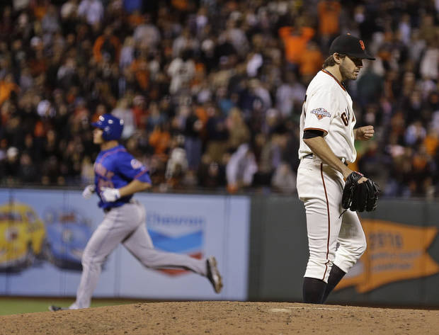 New York Mets' Anthony Recker, left, circles the bases after hitting a two run homer off San Francisco Giants starting pitcher Barry Zito, right, in the sixth inning of their baseball game Tuesday, July 9, 2013, in San Francisco. (AP Photo/Eric Risberg)