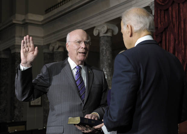 Vice President Joe Biden, right, reenacts the swearing in of Sen. Patrick Leahy, D-Vt., as President Pro Tempore of the Senate in the Old Senate Chamber on Capitol Hill in Washington, Tuesday, Dec. 18, 2012. (AP Photo/Susan Walsh)