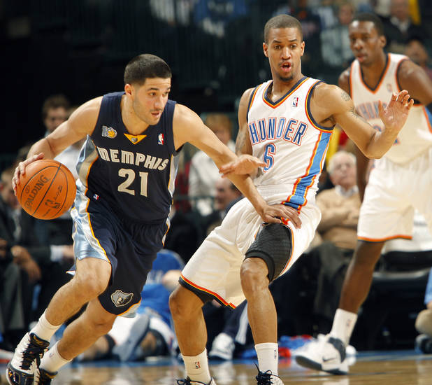 The Thunder's Eric Maynor (6) defends on Memphis' Greivis Vasquez (21) during the NBA basketball game between the Oklahoma City Thunder and the Memphis Grizzlies at the Oklahoma City Arena on Tuesday, Feb. 8, 2011, Oklahoma City, Okla.