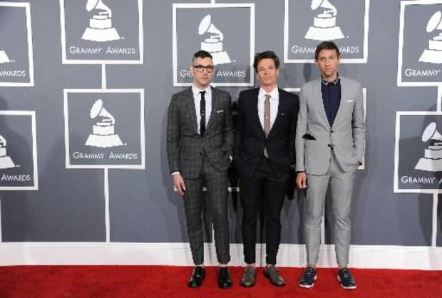 Musical group fun., from left, Jack Antonoff, Nate Ruess and Andrew Dost arrive at the 55th annual Grammy Awards on Sunday, Feb. 10, 2013, in Los Angeles. (AP)