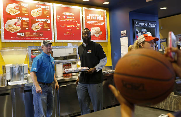 James Harden of the Oklahoma City Thunder brings food to a customer at the new Raising Cane's in Edmond, Thursday, September 27, 2012. Photo by Bryan Terry, The Oklahoman