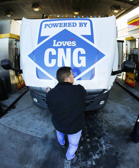 "Gemini Motor Transport driver Robert Felts opens the hood of his truck during the opening of Love's Travel Stops first ""fast fill"" CNG facility for heavy-duty trucks Monday at Interstate 40 and Morgan Road in Oklahoma City. Photo By Steve Gooch, The Oklahoman <strong>Steve Gooch</strong>"