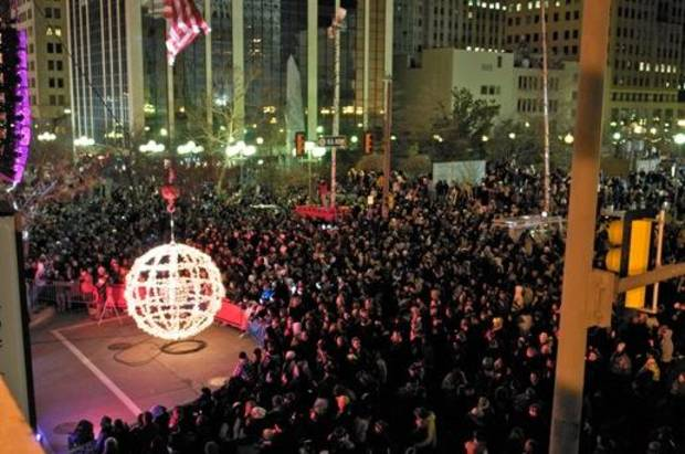 A crowd waits for the giant lighted ball to ascend to mark the start of a new year at a past Opening Night New Year's Eve celebration in downtown Oklahoma City. An estimated 70,000 people attended the grand finale of last year's Opening Night.