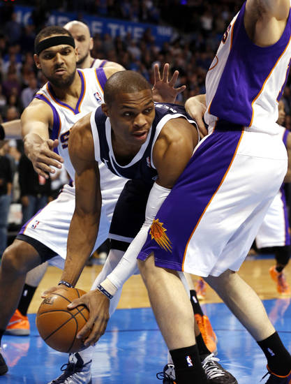 Oklahoma City Thunder's Russell Westbrook (0) looks for a passing lane as the Oklahoma City Thunder play the Phoenix Suns in NBA basketball at the Chesapeake Energy Arena in Oklahoma City, on Monday, Dec. 31, 2012.  Photo by Steve Sisney, The Oklahoman
