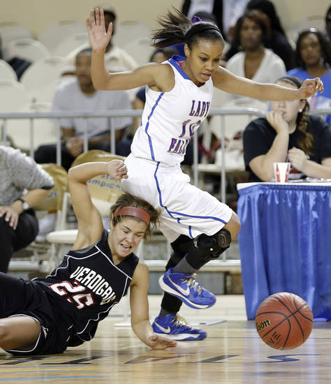 Verdigris&#039; Baileigh O&#039;Dell (25) and Millwood&#039;s Teanna Reid (10) chase down a loose ball during the 3A girls quarterfinals game between Millwood High School and Verdigris High School at the State Fair Arena on Thursday, March 7, 2013, in Oklahoma City, Okla. Photo by Chris Landsberger, The Oklahoman