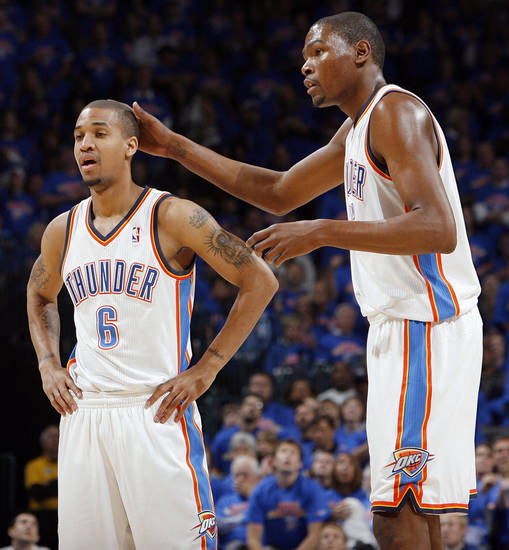 Oklahoma City's Kevin Durant (35), right, pats Eric Maynor (6) on the head in the first half during game 7 of the NBA basketball Western Conference semifinals between the Memphis Grizzlies and the Oklahoma City Thunder at the OKC Arena in Oklahoma City, Sunday, May 15, 2011. Photo by Nate Billings, The Oklahoman