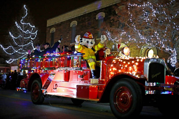 A lighted firetruck drives down the street during the Edmond Electric Parade of Lights in downtown Edmond, Okla., Saturday, Dec. 8, 2012. Photo by Bryan Terry, The Oklahoman