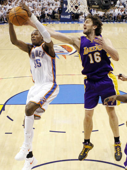 L.A. LAKERS: Oklahoma City's Kevin Durant (35) moves to the hoop past Pau Gasol (16) of L.A. during the NBA basketball game between the Los Angeles Lakers and the Oklahoma City Thunder in the first round of the NBA playoffs at the Ford Center in Oklahoma City, Saturday, April 24, 2010. Photo by Nate Billings, The Oklahoman ORG XMIT: KOD