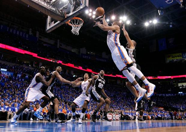 Oklahoma City's Russell Westbrook (0) shoots during Game 3 of the Western Conference Finals between the Oklahoma City Thunder and the San Antonio Spurs in the NBA playoffs at the Chesapeake Energy Arena in Oklahoma City, Thursday, May 31, 2012.  Photo by Sarah Phipps, The Oklahoman