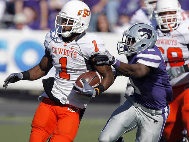 Oklahoma State's Joseph Randle (1) gets past Kansas State's Stephen Harrison (8) during the first half of the college football game between the Oklahoma State University Cowboys (OSU) and the Kansas State University Wildcats (KSU) on Saturday, Oct. 30, 2010, in Manhattan, Kan.   Photo by Chris Landsberger, The Oklahoman