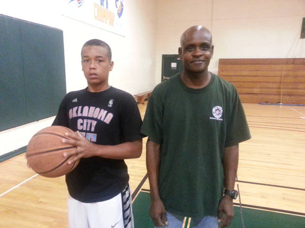 Al Taylor and a kid who plays basketball at Woodson Park pose for a photo before playing a game in the gym. Photo by Chris Brannick, The Oklahoman.