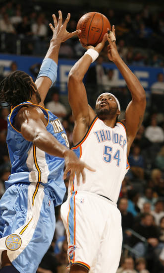 Nene tries to block a shot by Chris Wilcox in the second half as the Oklahoma City Thunder play the Denver Nuggets at the Ford Center in Oklahoma City, Okla. on Friday, January 2, 2009.  Photo by Steve Sisney/The Oklahoman