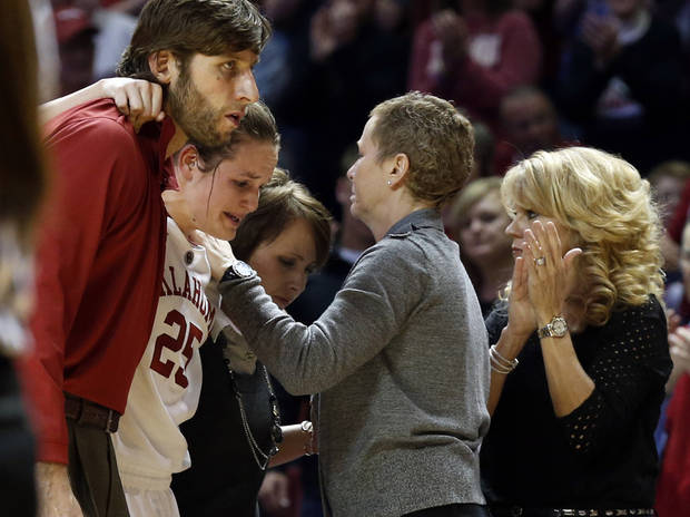 Whitney Hand is helped off the court after an injury by strength coach Jozsef Szendrei and trainer Carolyn Loon as she passes assistant coach Jan Ross and head coach Sherri Coale as the University of Oklahoma Sooners (OU) play the North Texas Mean Green in NCAA, women&#039;s college basketball at The Lloyd Noble Center on Thursday, Dec. 6, 2012  in Norman, Okla. Photo by Steve Sisney, The Oklahoman