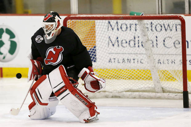New Jersey Devils goalie Martin Brodeur blocks a shot during the team's first official practice since the NHL hockey lockout ended, Sunday, Jan. 13, 2013, in Newark, N.J. (AP Photo/Julio Cortez)