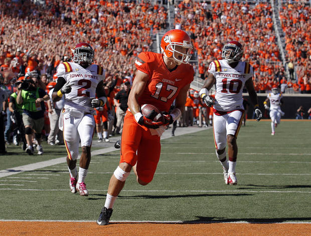 CELEBRATION: Oklahoma State's Charlie Moore (17) celebrates as he scores a touchdown in the second quarter as Iowa State's Jansen Watson (2) and Jacques Washington (10) chase him during a college football game between Oklahoma State University (OSU) and Iowa State University (ISU) at Boone Pickens Stadium in Stillwater, Okla., Saturday, Oct. 20, 2012. Photo by Sarah Phipps, The Oklahoman