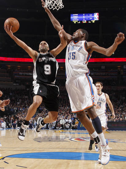 San Antonio&#039;s Tony Parker drives past Oklahoma City&#039;s Kevin Durant during the NBA basketball game between the Oklahoma City Thunder and the San Antonio Spurs at the Ford Center in Oklahoma City, Wednesday, January 13, 2010. Photo by Bryan Terry, The Oklahoman