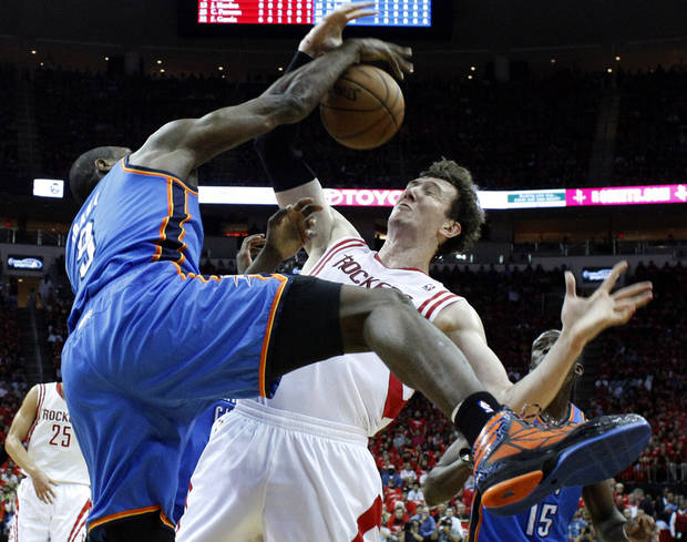 Oklahoma City's Serge Ibaka (9) defends against Houston's Omer Asik (3) during Game 4 in the first round of the NBA playoffs between the Oklahoma City Thunder and the Houston Rockets at the Toyota Center in Houston, Texas, Monday, April 29, 2013. Photo by Bryan Terry, The Oklahoman