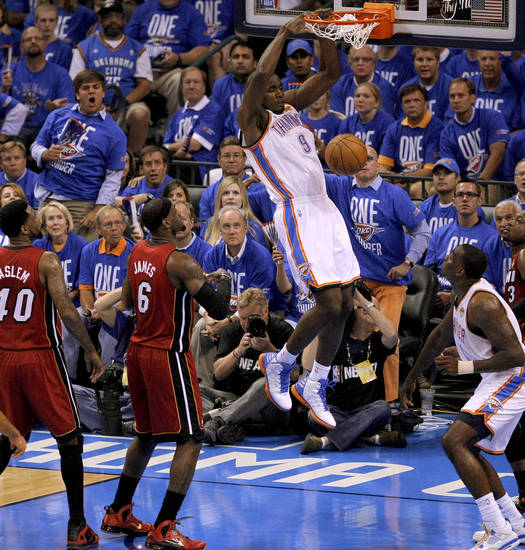 Oklahoma City's Serge Ibaka (9) dunks the ball beside Miami's LeBron James (6) and Udonis Haslem (40) as Kendrick Perkins watches during Game 1 of the NBA Finals between the Oklahoma City Thunder and the Miami Heat at Chesapeake Energy Arena in Oklahoma City, Tuesday, June 12, 2012. Photo by Sarah Phipps, The Oklahoman