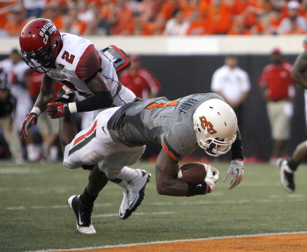 Oklahoma State's Joseph Randle scores a touchdown in front of Louisiana-Lafayette's Jemarlous Moten. Photo by Sarah Phipps, The Oklahoman
