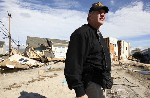 Seaside Heights Police Chief Tom Boyd stands near destroyed homes on Rt. 35 north in Ortley Beach, N.J.. Wednesday, Oct. 31, 2012. (AP Photo/Star-Ledger, David Gard/POOL)
