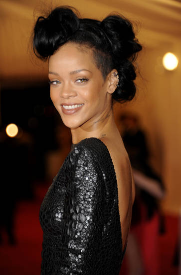 Rihanna arrives at the Metropolitan Museum of Art Costume Institute gala benefit, celebrating Elsa Schiaparelli and Miuccia Prada, Monday, May 7, 2012 in New York. (AP Photo/Evan Agostini)