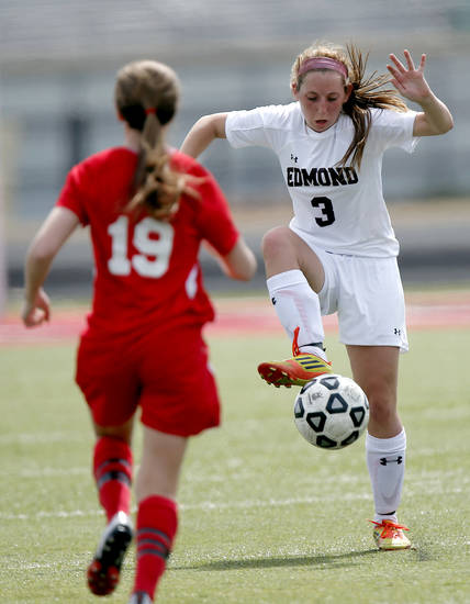 GIRLS HIGH SCHOOL SOCCER: Yukon's Ashlyn Collier (19) defends on Edmond's Hailey Drylie (3) during the Bronco Cup Soccer Tournament at Mustang High School on Thursday, March 28, 2013, in Mustang, Okla.  Photo by Chris Landsberger, The Oklahoman