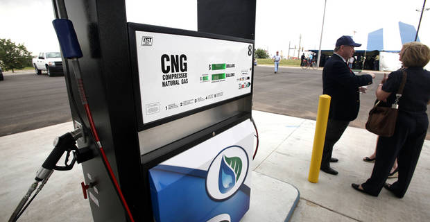 John Johnson, executive director of the Association of Central Oklahoma Governments, in the background, visits with a guest near a pumping bay at the grand opening of Norman's compressed natural gas fueling station. PHOTO BY PAUL B. SOUTHERLAND, THE OKLAHOMAN <strong>PAUL B. SOUTHERLAND</strong>
